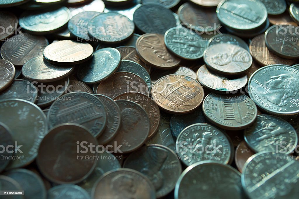 Sea of Coins against a early sunrise stock photo