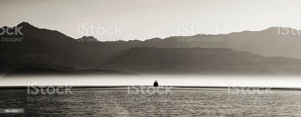 Sea of Cortez Gray Morning with Boat stock photo