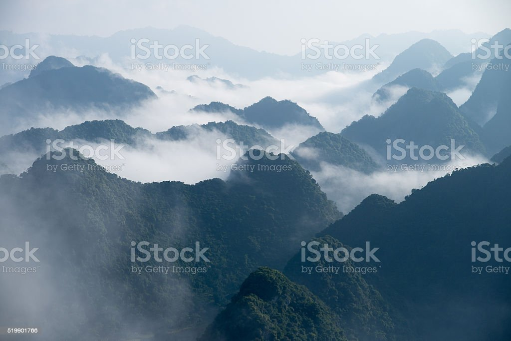 Sea of mist over the mountains stock photo