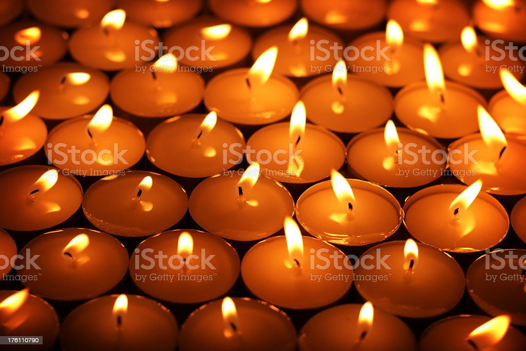 Sea of tealight candles stock photo