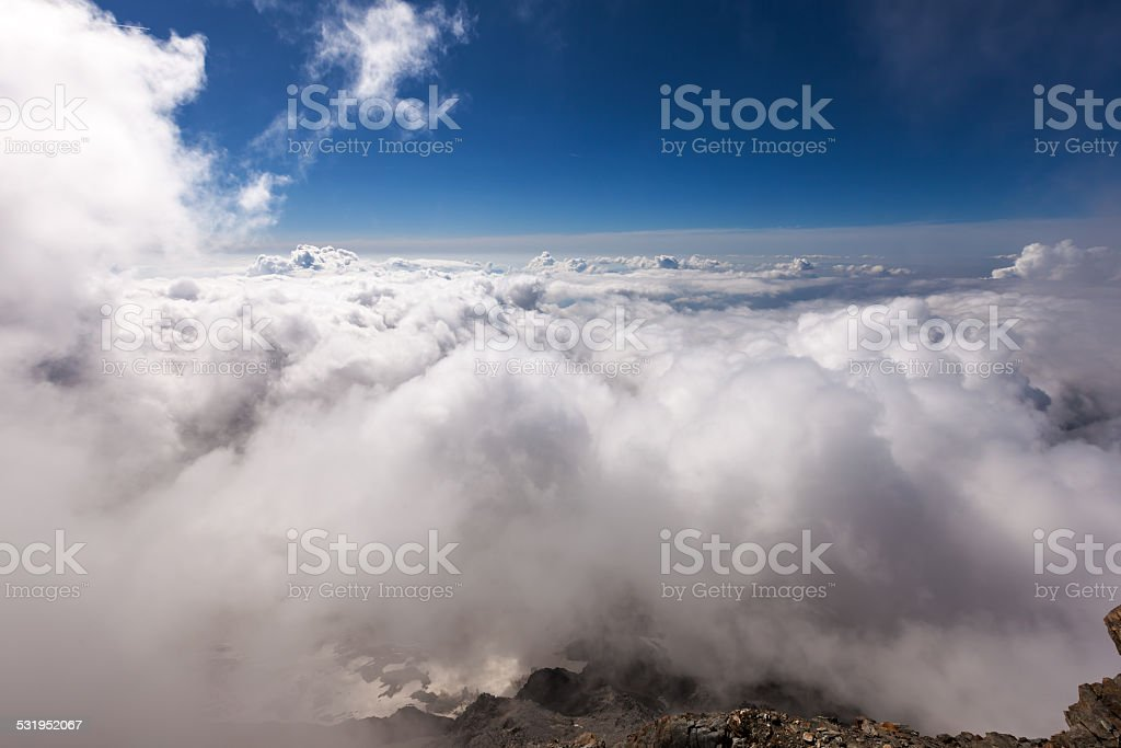 Sea of white clouds over the Alps stock photo