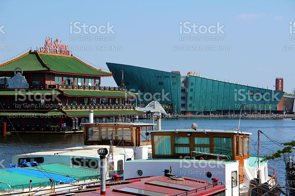 Sea Palace Chinese Restaurant and Nemo Science Center in Amsterdam stock photo