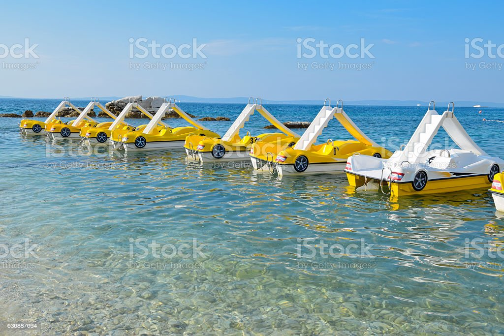 Sea peddle boats on the water surface stock photo