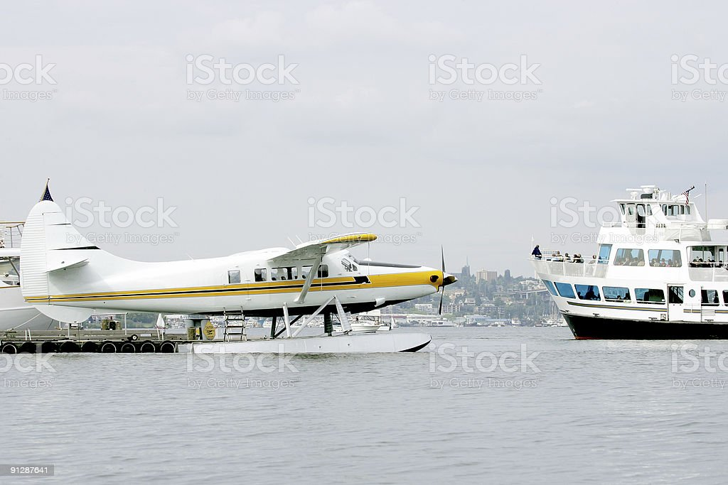 Sea plane and cruise boat royalty-free stock photo