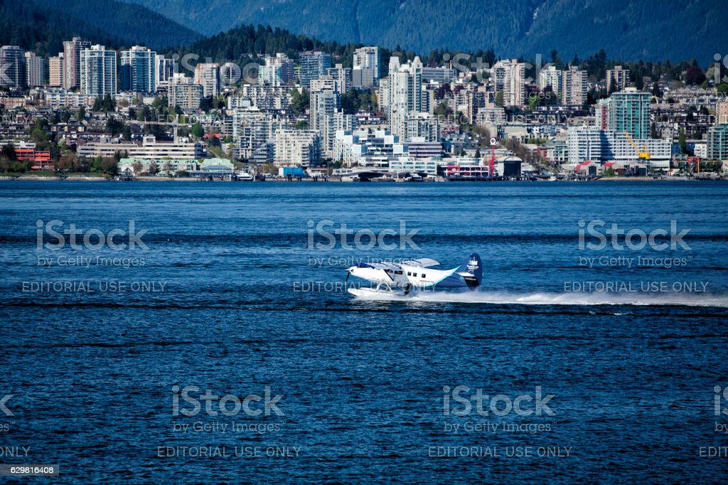 Sea plane taking off at Vancouver harbour stock photo