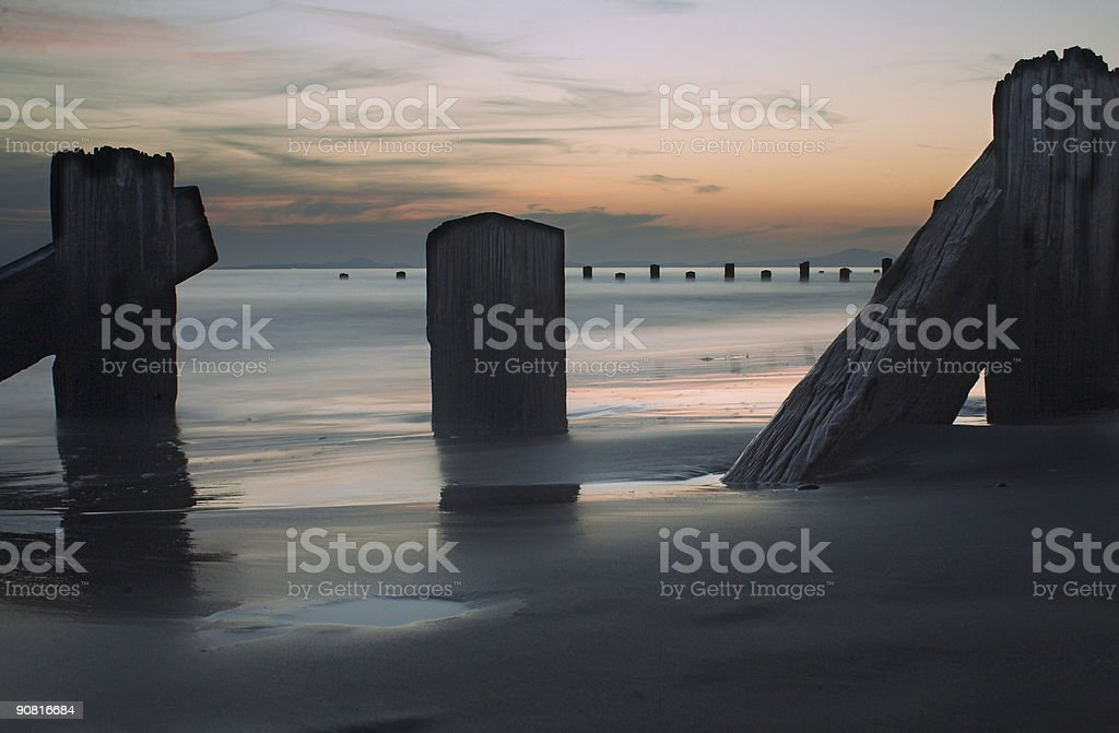Sea, poles and sunset royalty-free stock photo