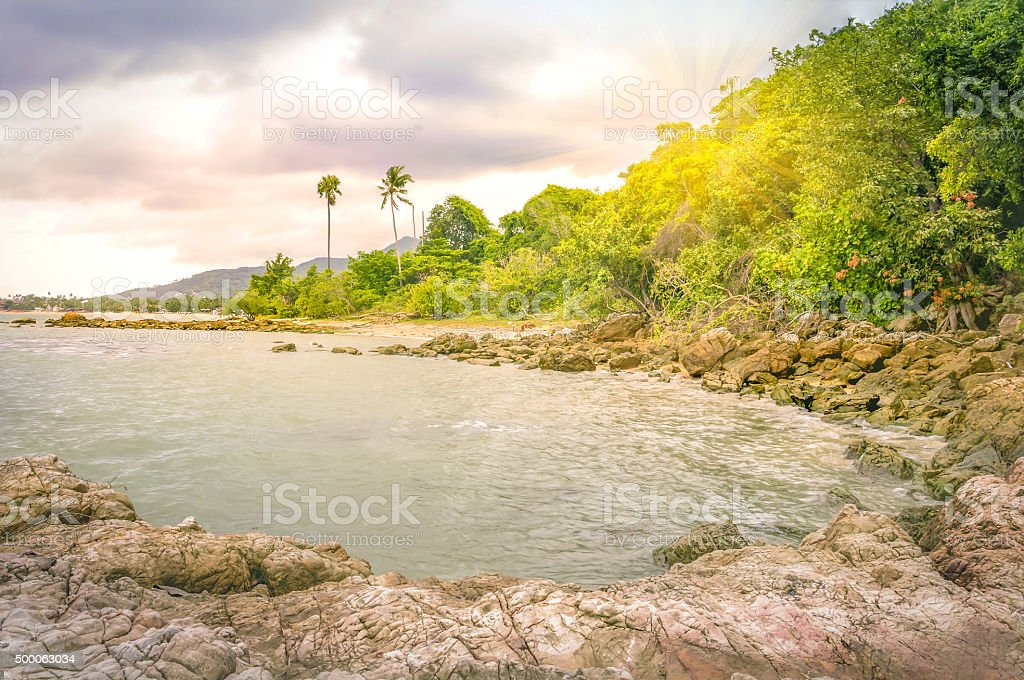 Sea rock with sunlay at Samui, Thailand stock photo