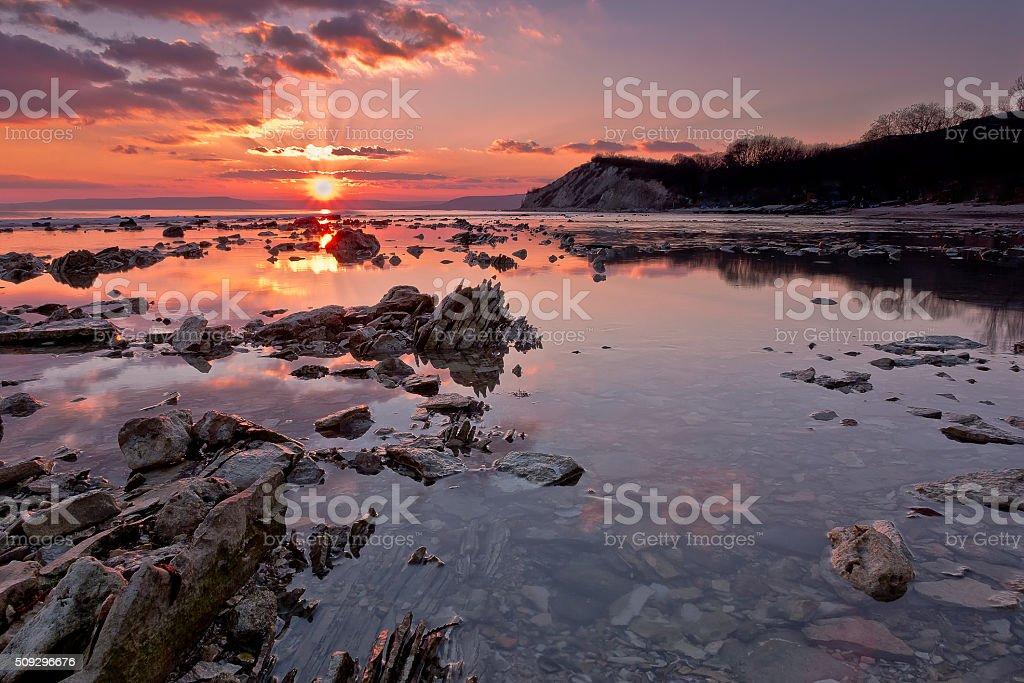 Sea rocks at sunset. stock photo