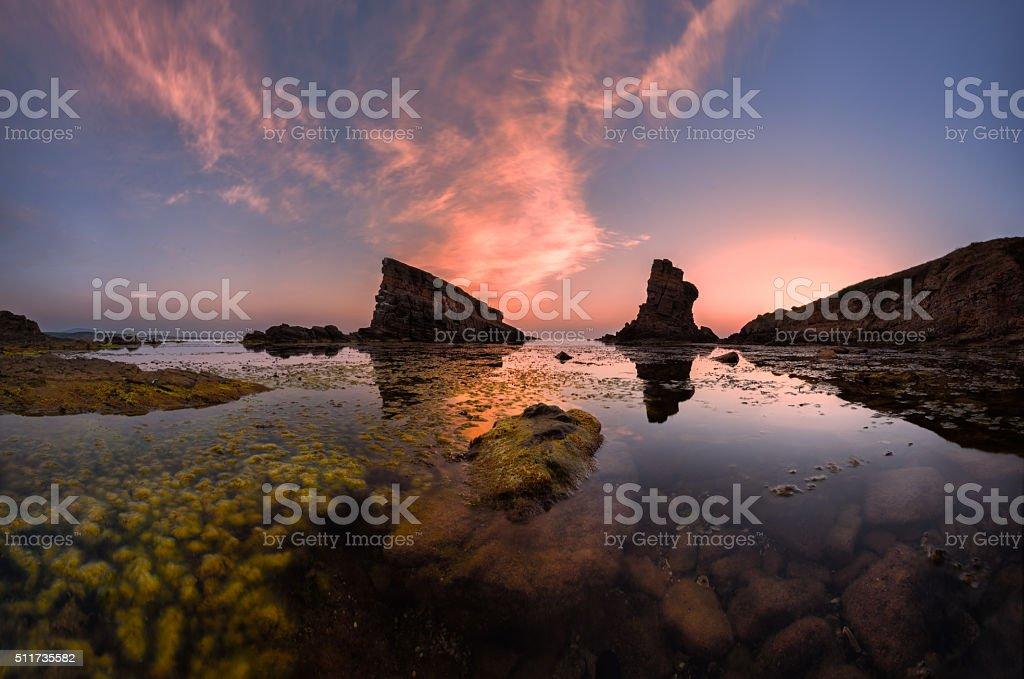 Sea rocks in the sunrise stock photo