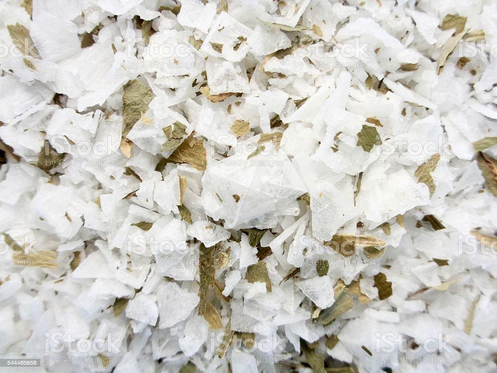 Sea salt crystals with wild garlic herbs stock photo