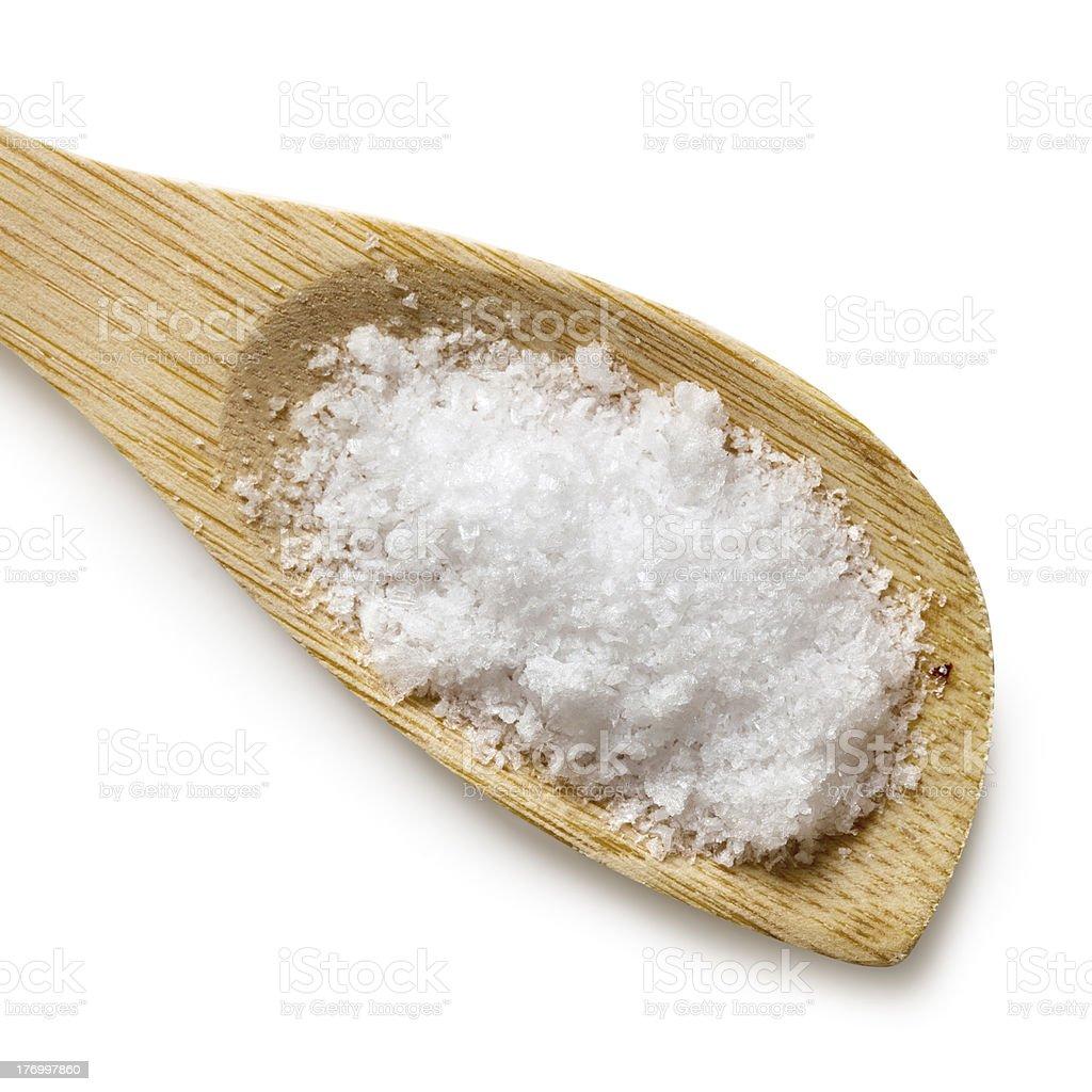 Sea Salt Flakes on Wooden Spoon Isolated stock photo