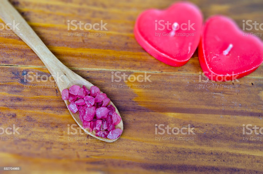 Sea salt in a spoon on a wooden table royalty-free stock photo