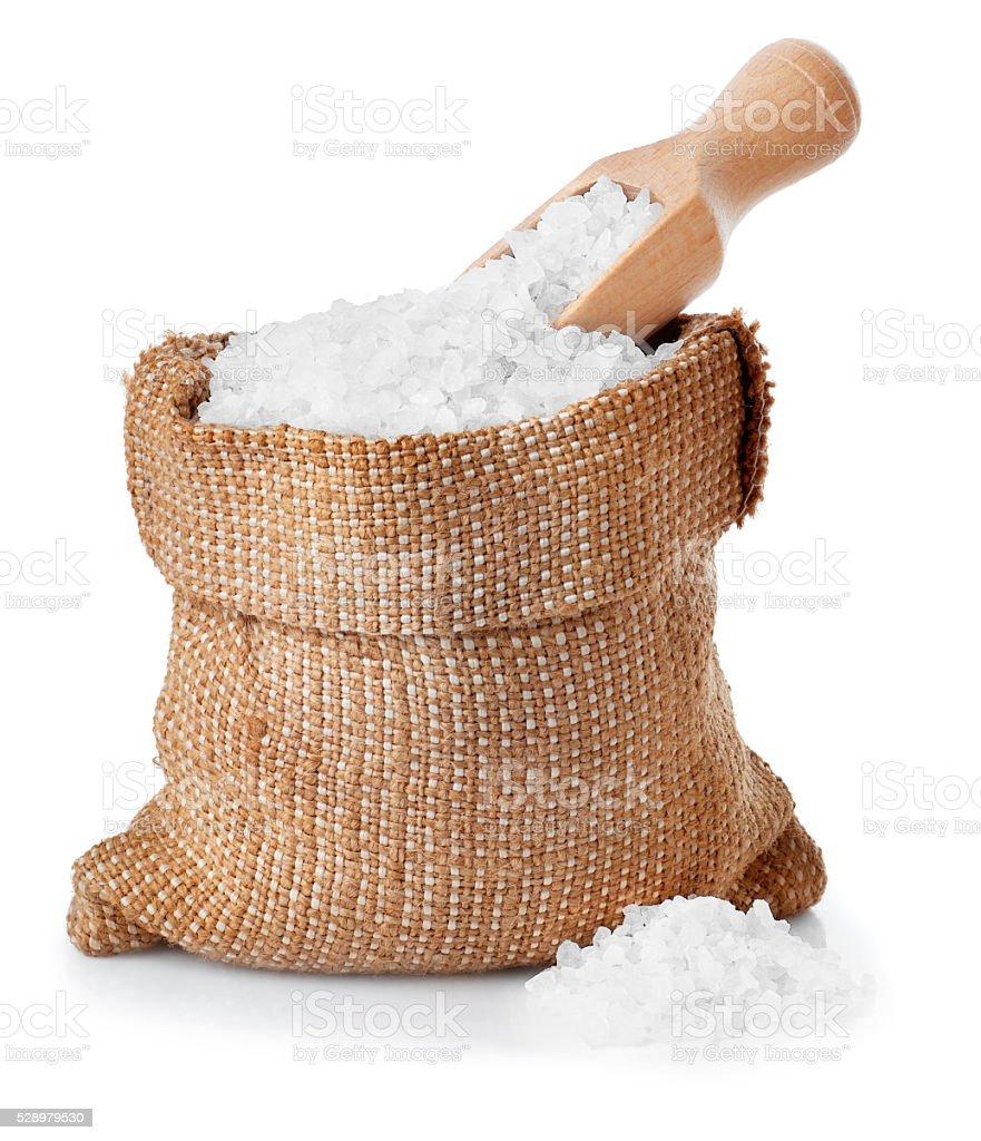 Sea salt in burlap sack isolated on white stock photo