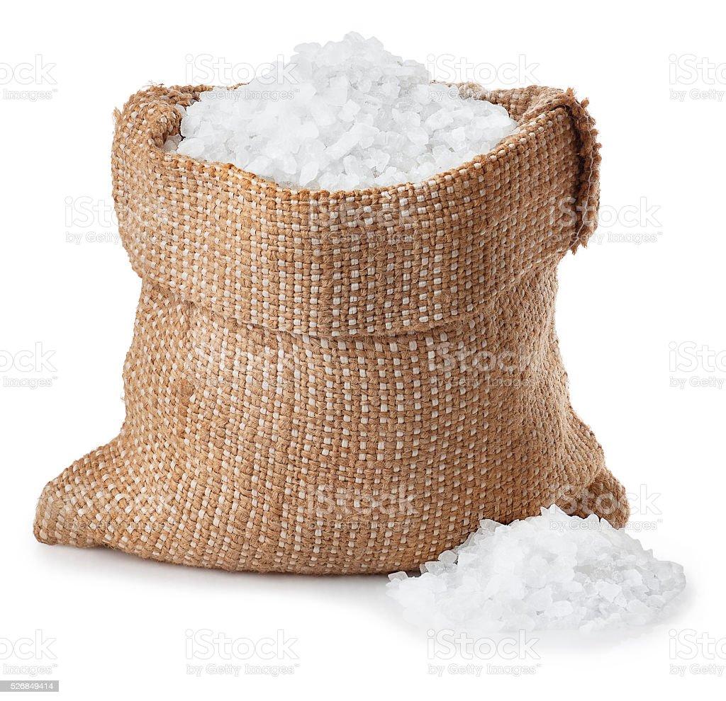 Sea salt in sack isolated on white stock photo