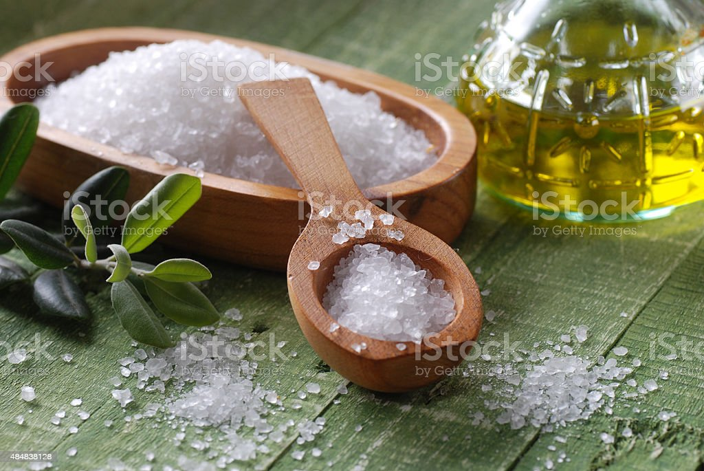 sea salt in the spoon stock photo