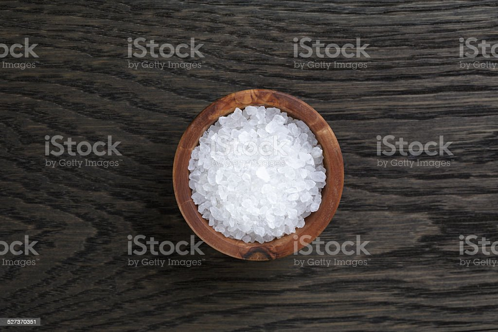 sea salt in wooden bowl for cooking or spa stock photo