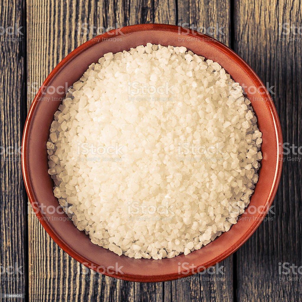 Sea salt on old wooden table stock photo