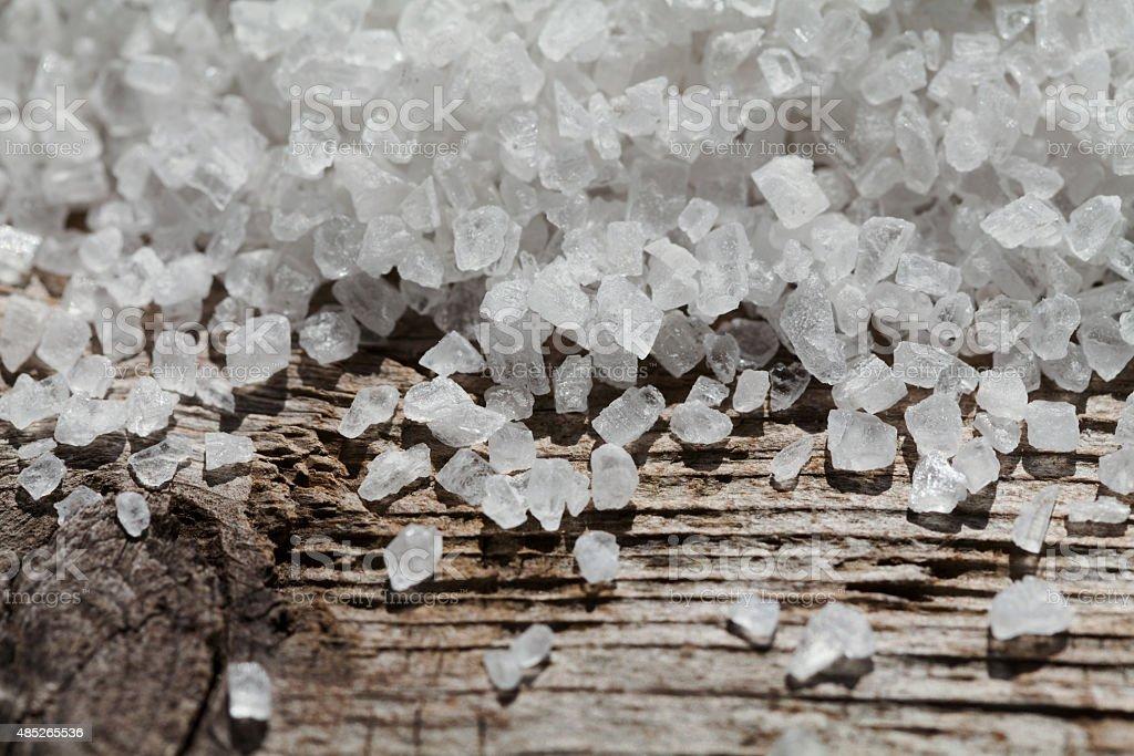 Sea salt on rustic wooden background stock photo