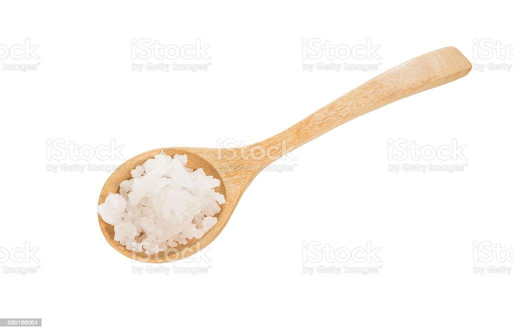 sea salt on wooden spoon stock photo