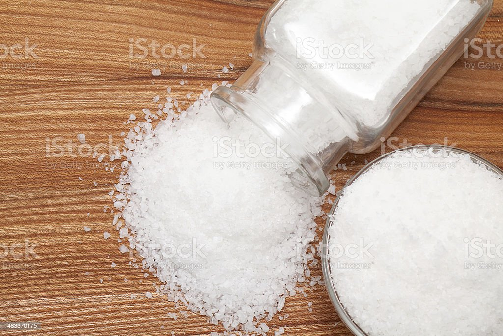 sea salt on wooden table stock photo