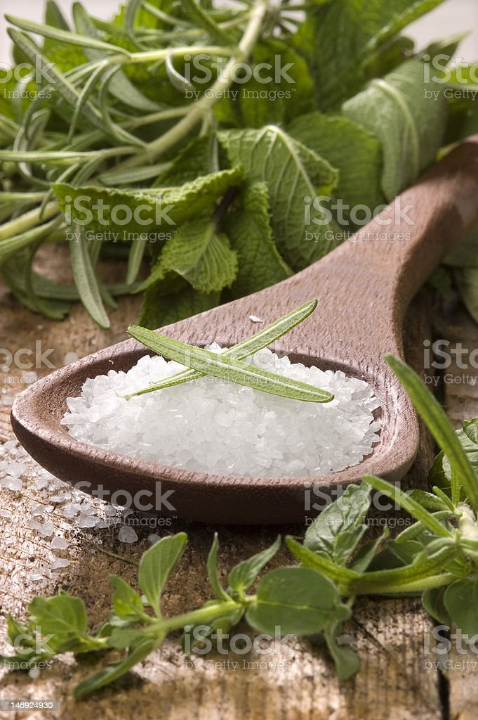 sea salt with herbs in a wooden spoon royalty-free stock photo