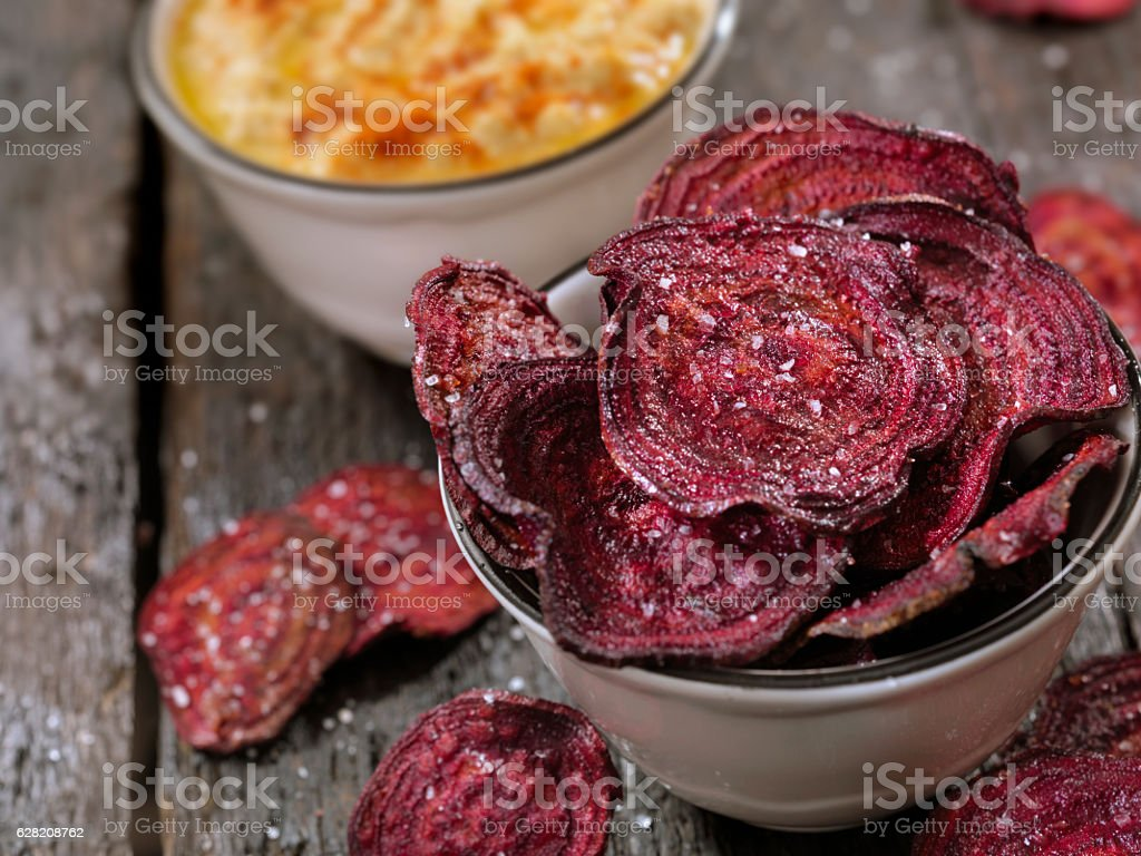 Sea Salted Beet Chips with a Hummus Dip stock photo