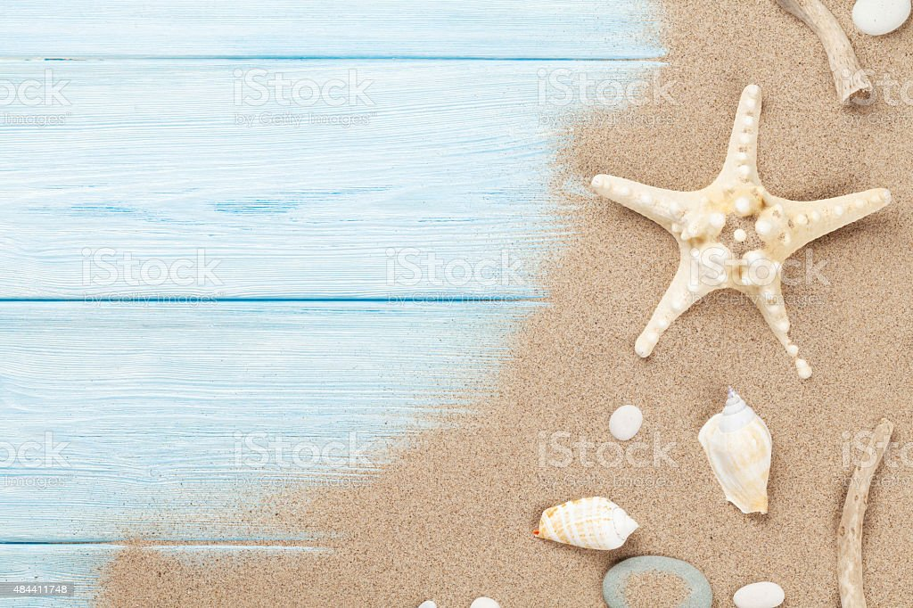 Sea sand with starfish and shells stock photo