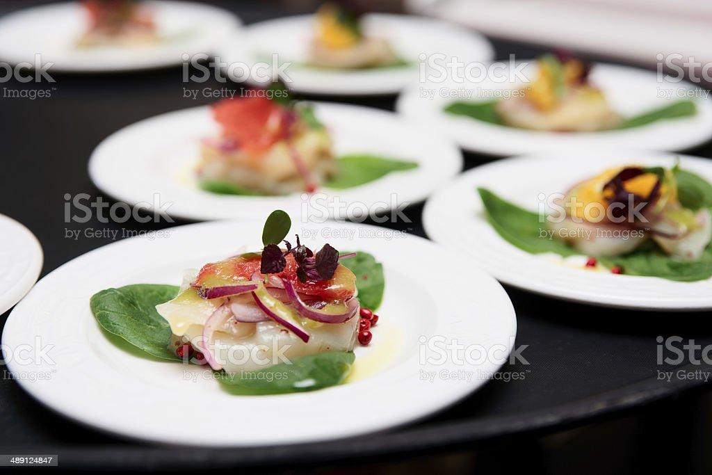 Sea scallop carpaccio dishes royalty-free stock photo