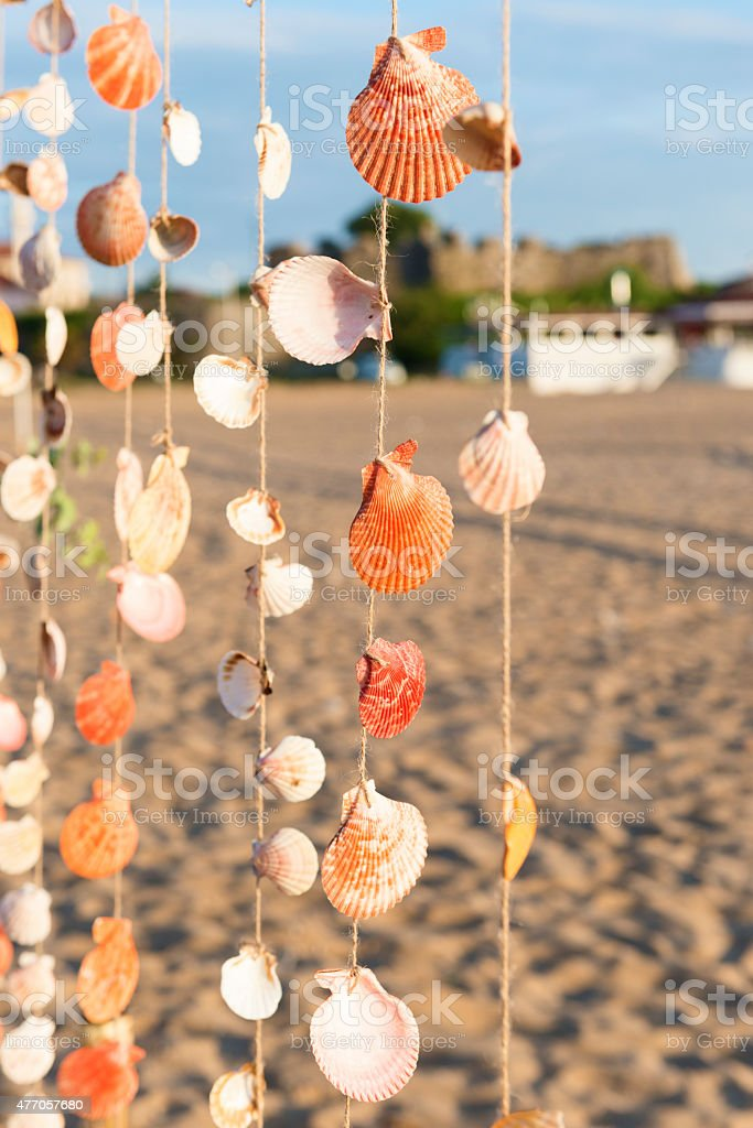 Sea shell curtain selective focus stock photo