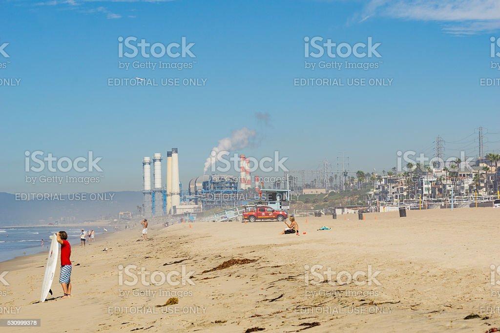 Sea spray and fog with industrial smog shrouds Californian beach stock photo