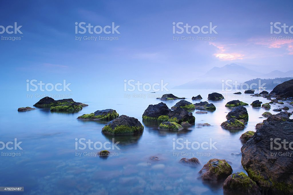 Sea stones at sunset stock photo