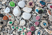 sea stones painted by the children on the beach