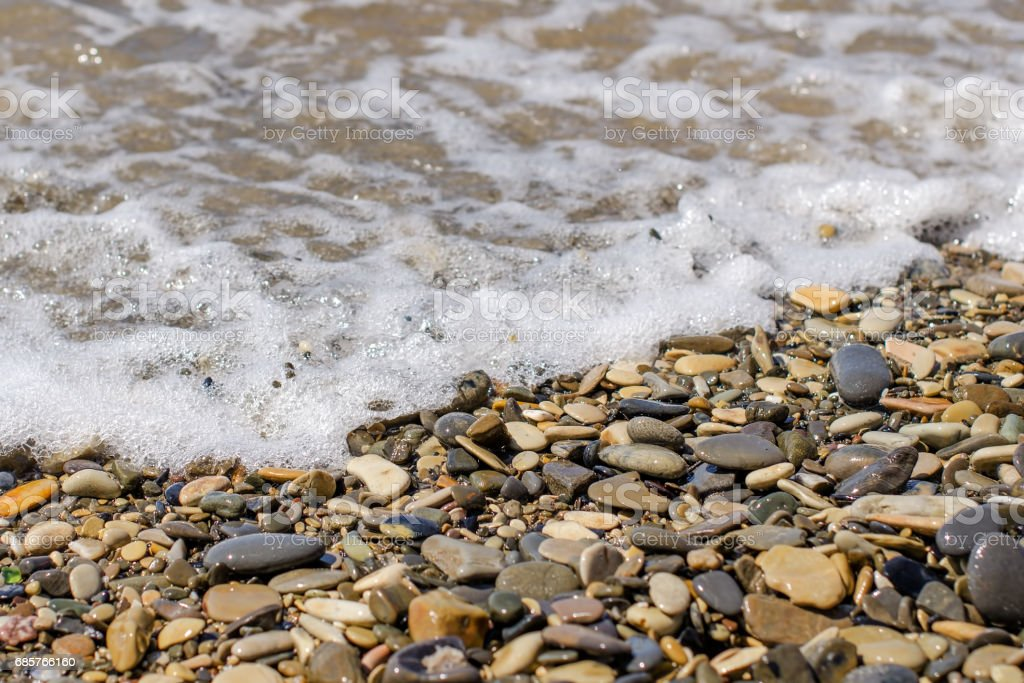 sea stones washed by the waves stock photo