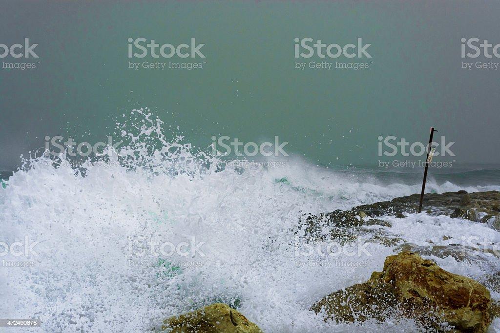 Sea storm waves dramatically crashing and splashing against rocks stock photo
