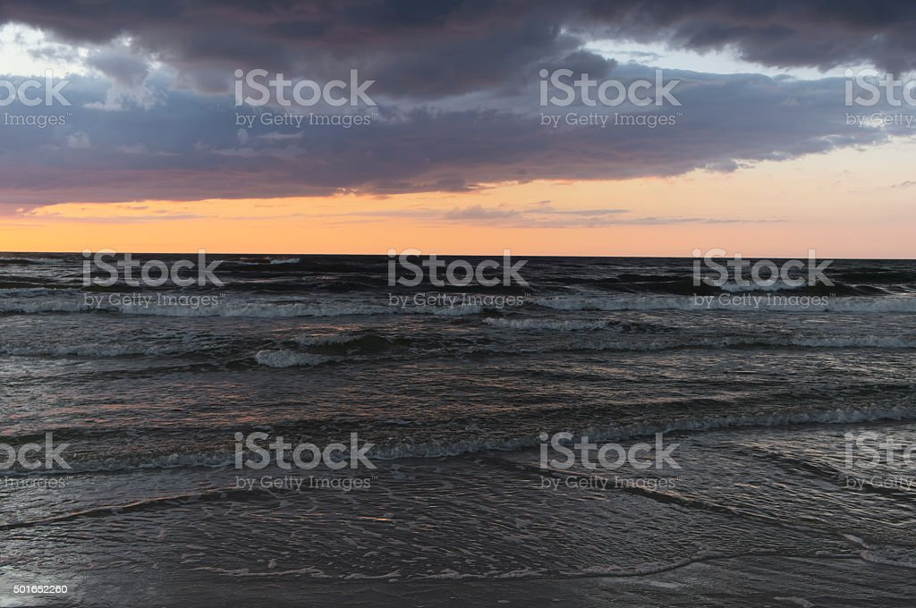 Sea sunset and heavy clouds. stock photo
