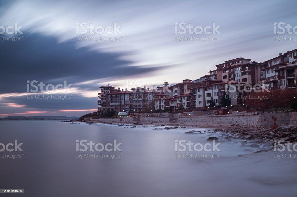 Sea sunset at the coastal city stock photo
