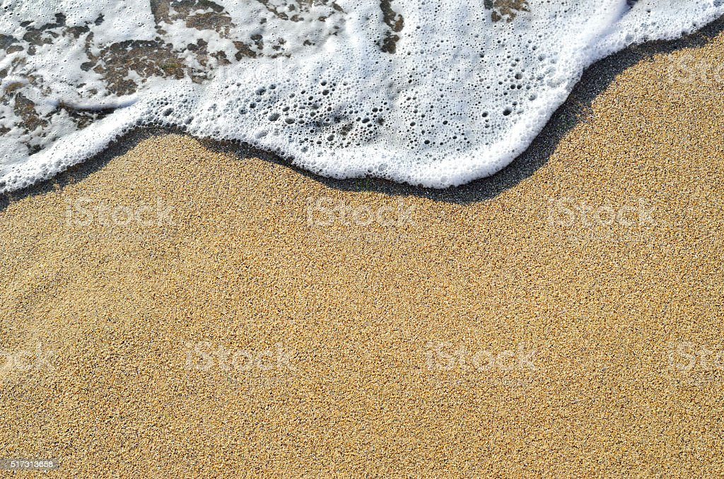 Sea surf and the word relax on the sand stock photo