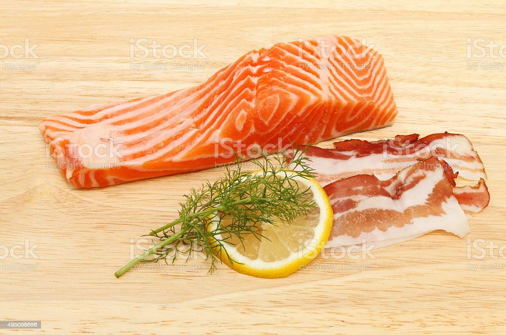 Sea trout and pancetta stock photo