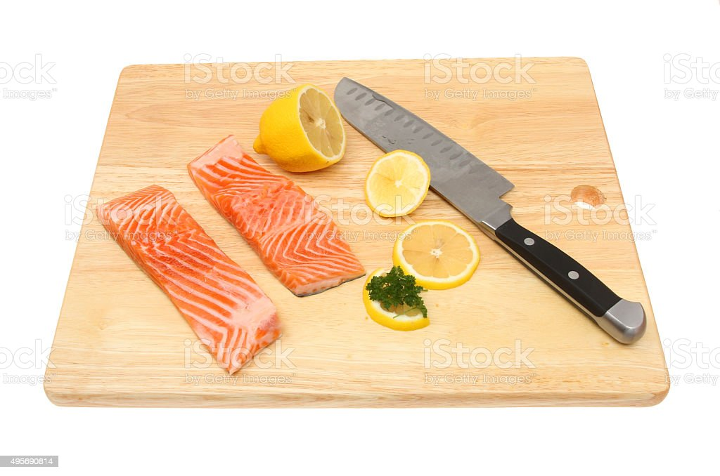 Sea trout fillets on a board stock photo