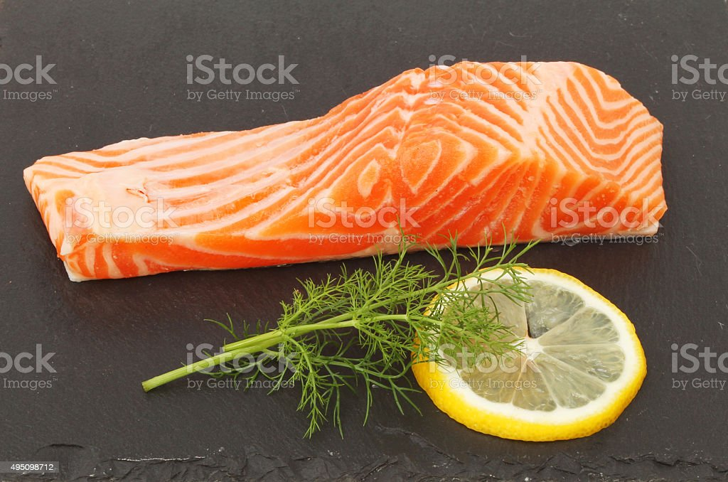 Sea trout on slate stock photo