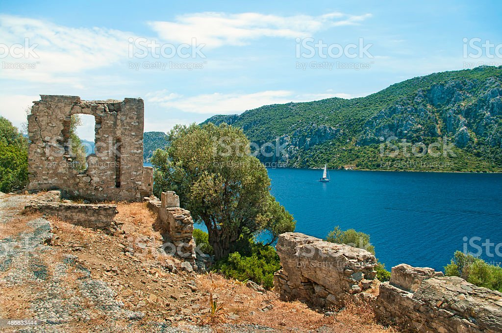 sea view from ruined stone wall stock photo