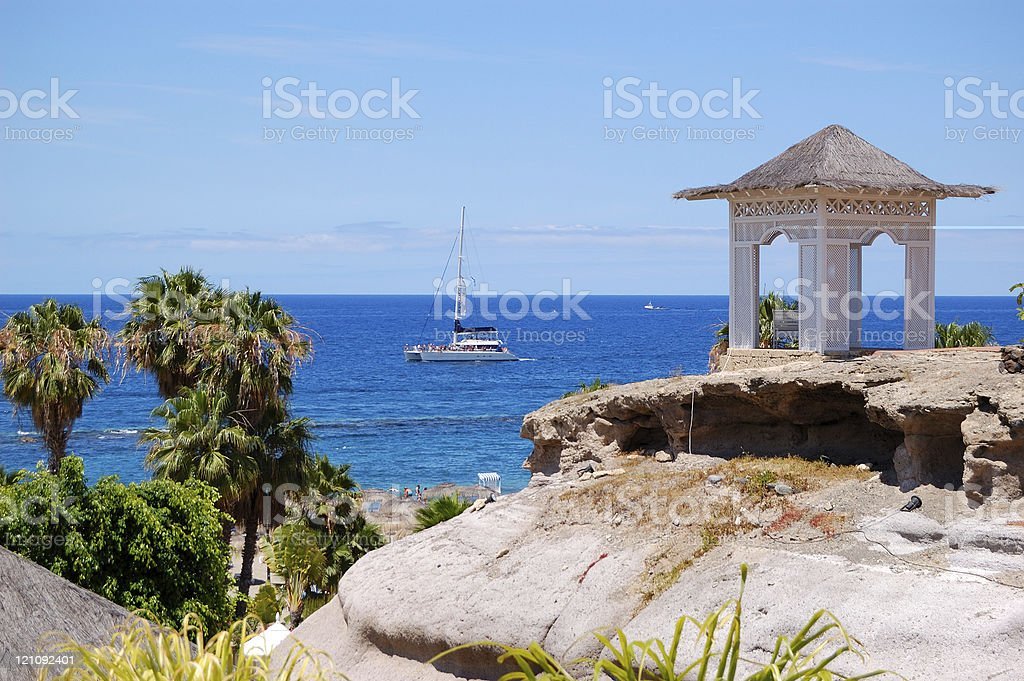 Sea view hut with bench over beach at luxury hotel stock photo