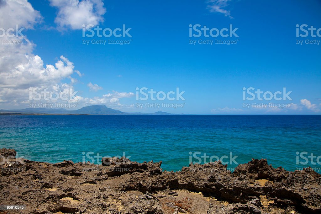 Sea View Lava Rock and Mountains stock photo
