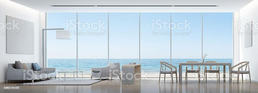 Sea view living room and dining room in modern house stock photo