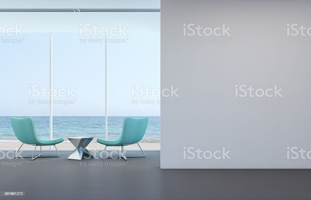 Sea view living room with white wall in modern house stock photo