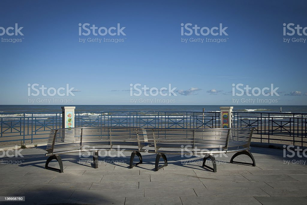 Sea view with benchs stock photo