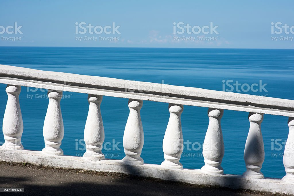 Sea view with white balustrade stock photo