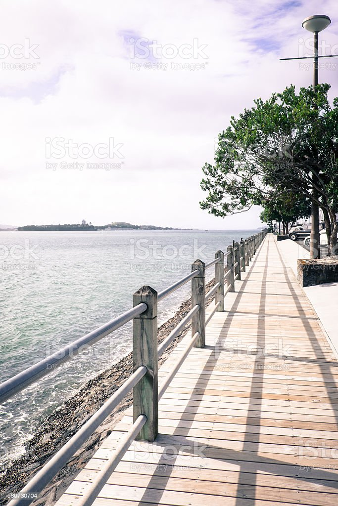 Sea wall at Auckland Harbour stock photo