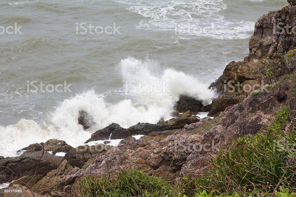 sea wave clash rock stock photo