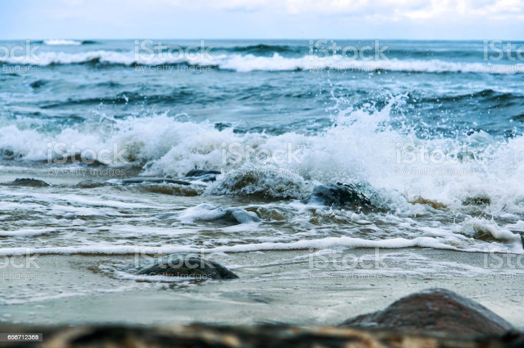 sea wave waves beat on the rocks stock photo